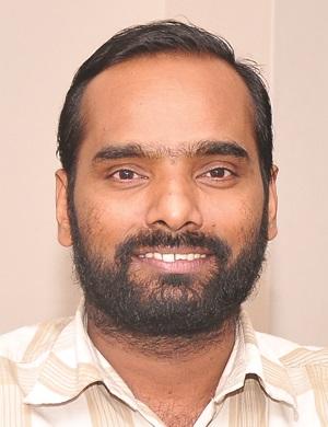 Dr. E. Radhakrishnan